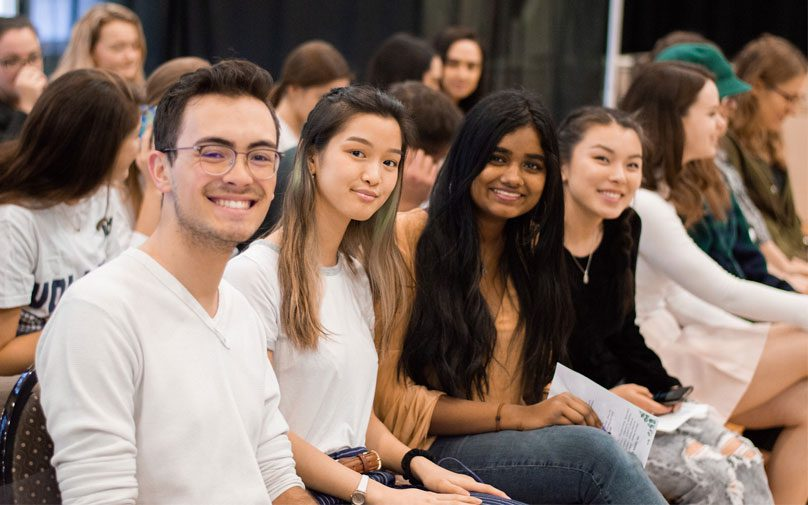 A group of students smile for the camera